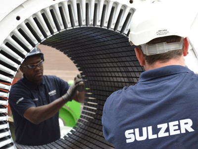 wo Sulzer employees fixing a Hydro power system