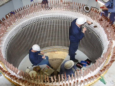 Sulzer employees fixing a Hydro power system